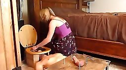 Mature blonde wife torturing her submissive man
