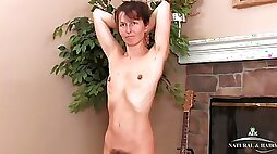 Skinny older lady looks stunning as she strips