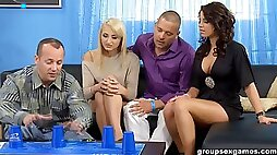 Two couples play a sex game that ends in a double penetration