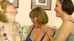 Three naughty European ladies on the bed playing sofcore games