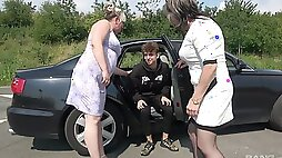 A pair of horny old broads tag team a young buck on the road