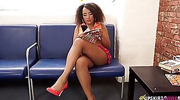 Ebony chick Kayla Louise spreads legs open and teases with her yummy pussy upskirt
