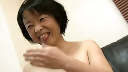Short haired MILF Tomoe Nakamachi flashes tits strips for dude
