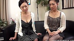 Intimate girl on girl action on camera with Asian couple