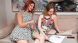 Sensual models Siiri and Sophie are kissing and fucking on the sofa
