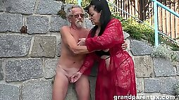 Young girl joins a much older lady for a public fourway fuck