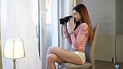 Svelte young chick Akira May gets horny while spying on neighbors